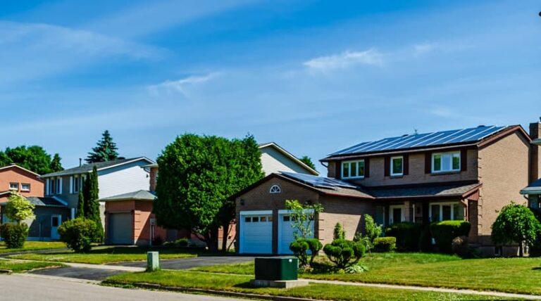 neighborhood-with-solar-panel-on-top-of-houses